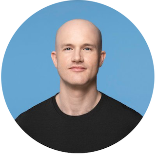 A headshot of Brian Armstrong, Coinbase CEO, smiling in a black tee shirt